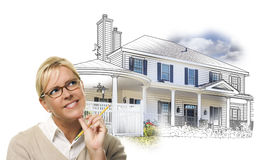Woman with Pencil In Front of House Drawing and Photo on White Stock Photos