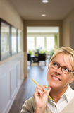 Woman with Pencil Inside Hallway of House Royalty Free Stock Photos