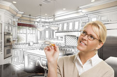 Woman With Pencil Over Custom Kitchen Design Drawing and Photo C Stock Photography