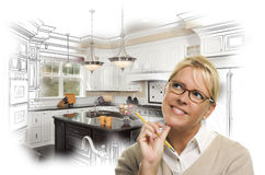 Woman With Pencil Over Custom Kitchen Design Drawing and Photo. Creative Woman With Pencil Over Custom Kitchen Design Drawing and Photo Combination on White Stock Photos