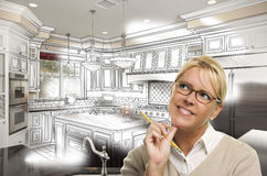 Woman With Pencil Over Custom Kitchen Design Drawing and Photo. Creative Woman With Pencil Over Custom Kitchen Design Drawing and Photo Combination on White Royalty Free Stock Photos