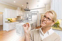 Woman With Pencil Over Custom Kitchen Drawing and Photo Combinat. Creative Woman With Pencil Over Custom Kitchen Design Drawing and Photo Combination Stock Photos