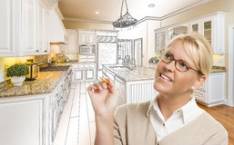 Woman With Pencil Over Custom Kitchen Drawing and Photo Combinat. Creative Woman With Pencil Over Custom Kitchen Design Drawing and Photo Combination Stock Photography