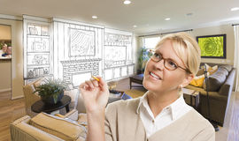 Woman with Pencil Over Custom Room and Design Drawing. Creative Woman with Pencil Over Custom Living Room and Design Drawing Stock Photos