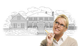Woman with Pencil Over House Drawing on White Stock Images