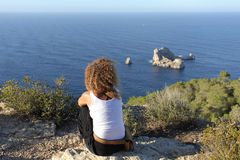 Woman Pensive Relaxing On A Cliff In Ibiza Island Royalty Free Stock Photo