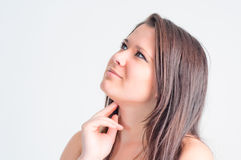 Woman pensively looks up Royalty Free Stock Image