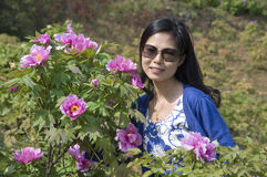 Woman and Peonies Royalty Free Stock Photography
