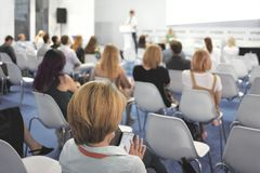 Woman and people Listening on The Conference. Horizontal Image.  stock photos