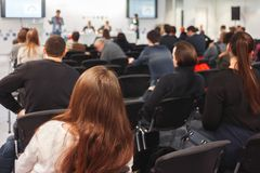 Woman and people Listening on The Conference. Horizontal Image. Royalty Free Stock Image