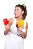Woman and pepper Stock Images