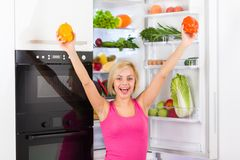 Woman pepper, refrigerator diet vegetables Royalty Free Stock Photography