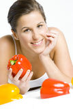 Woman with peppers Stock Image
