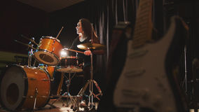 Woman percussion drummer performing with drums. Wide angle royalty free stock images