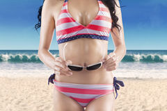 Woman with perfect body wearing bikini Royalty Free Stock Images