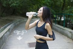 Woman with a perfect figure doing sports, fitness, drinking water royalty free stock image