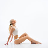 Woman with perfect figure in white underwear Royalty Free Stock Photography
