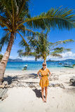 Woman on a perfect palm beach Royalty Free Stock Images
