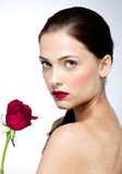 Woman with perfect skin holding red rose Royalty Free Stock Image