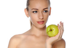 Woman with perfect skin. She holds in her hand a green apple Royalty Free Stock Images
