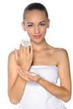 Woman with perfect skin and white flower in hand. Portrait of a beautiful young, fresh, healthy woman with perfect skin and white flower in hand against an Royalty Free Stock Photo