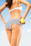Woman perfect slim body holding a pear. Stock Photography