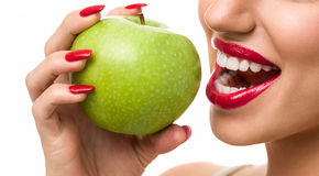 Woman with perfect teeth holding  red apple Stock Image