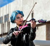Woman perform music on violin park outdoor. Girl performing jazz . Stock Images
