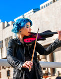 Woman perform music on violin park outdoor. Girl performing jazz . Royalty Free Stock Photography