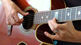 Woman performer hand play on guitar.  stock footage