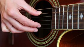 Woman performer hand play on guitar, close up.  stock video footage