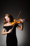 Woman performer with violin. In studio Stock Photo
