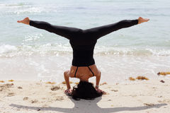 Woman Performing A Headstand Stock Images
