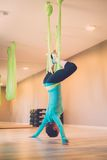 Woman performing antigravity yoga Royalty Free Stock Images