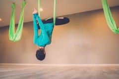 Woman performing antigravity yoga Royalty Free Stock Photos