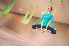 Woman performing antigravity yoga Royalty Free Stock Images