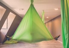 Woman performing antigravity yoga Royalty Free Stock Photography