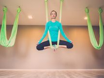 Woman performing antigravity yoga Stock Photography