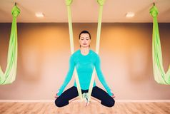 Woman performing antigravity yoga Stock Photo