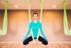 Woman performing antigravity yoga Stock Photo