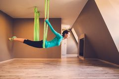 Woman performing antigravity yoga Stock Photos