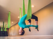 Woman performing antigravity yoga Royalty Free Stock Photo
