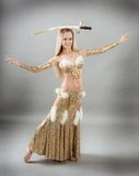 Woman performing arabic dance with sabre Stock Photos