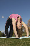 Woman Performing Chakrasana Royalty Free Stock Photo