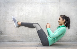 Woman performing core crunch exercise Stock Photo