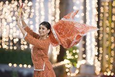 Woman performing Dandiya Raas on Navratri Royalty Free Stock Photography