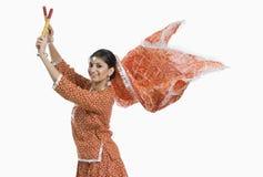 Woman performing Dandiya Raas on Navratri. Woman performing Dandiya Raas at Navratri royalty free stock images