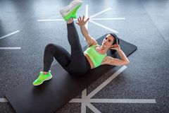 Woman performing exercise on gym floor royalty free stock images