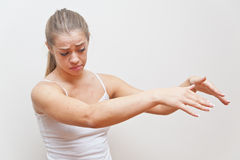 Woman performing gesture for AWAY FROM ME Stock Images