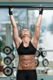 Woman Performing Hanging Leg Raises Exercise Royalty Free Stock Image